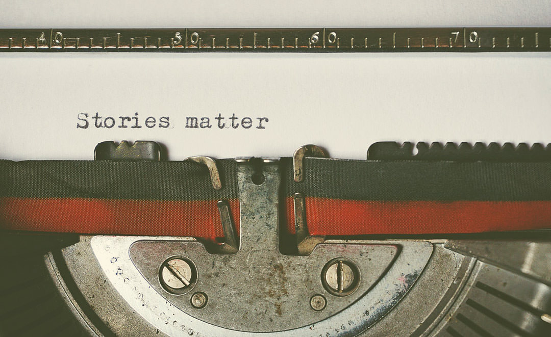 """A typewriter machine that has written in the paper the sentence """"Stories Matter"""""""